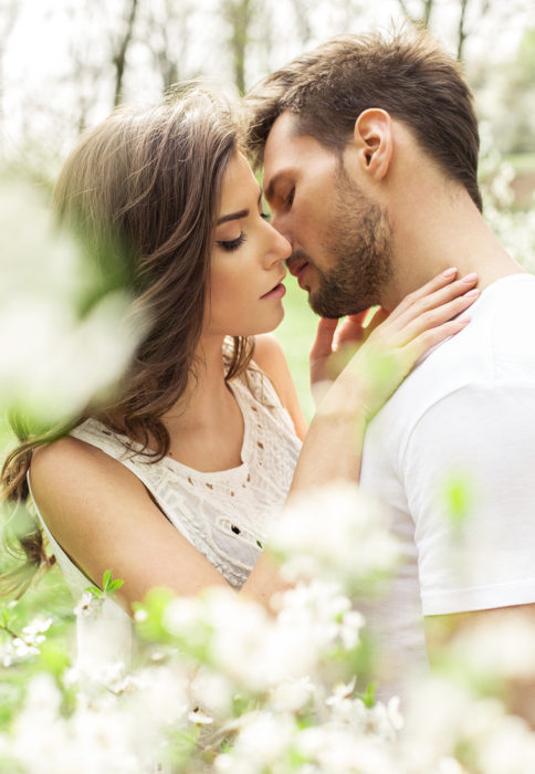 Portrait of kissing couple in the garden